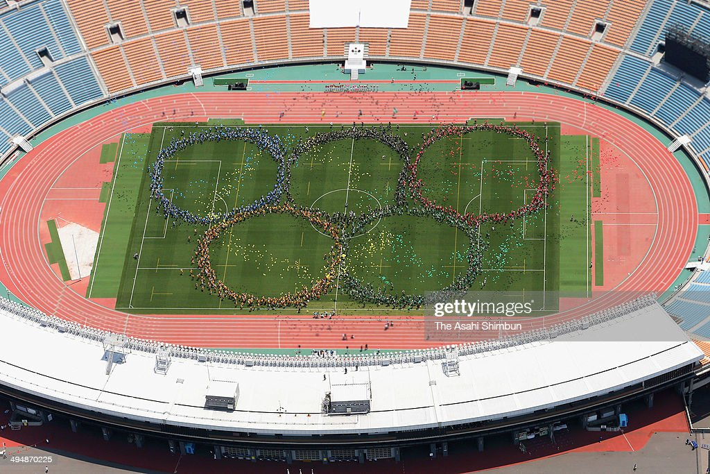 In this aerial image, the Olympic Rings are formed by human letters during the Sayonara National Stadium farewell event on May 31, 2014 in Tokyo, Japan. The National Stadium in Tokyo, originally built for 1964 Summer Olympics will be demolished to make way for a 80,000-seat stadium which will serve as the main venue of the 2020 Olympics.