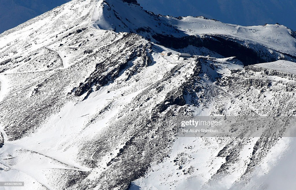 In this aerial image, the peak of Mount Fuji where four climbers slid down is seen on December 1, 2013 in Shizuoka, Japan. Two men were confirmed dead by Monday December 2, 2013.