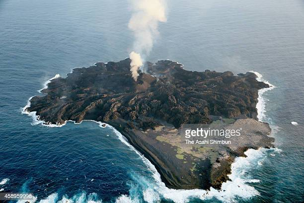 In this aerial image the recently formed islet which is connected to neighboring Nishinoshima island continues its volcanic activity on April 7 2014...