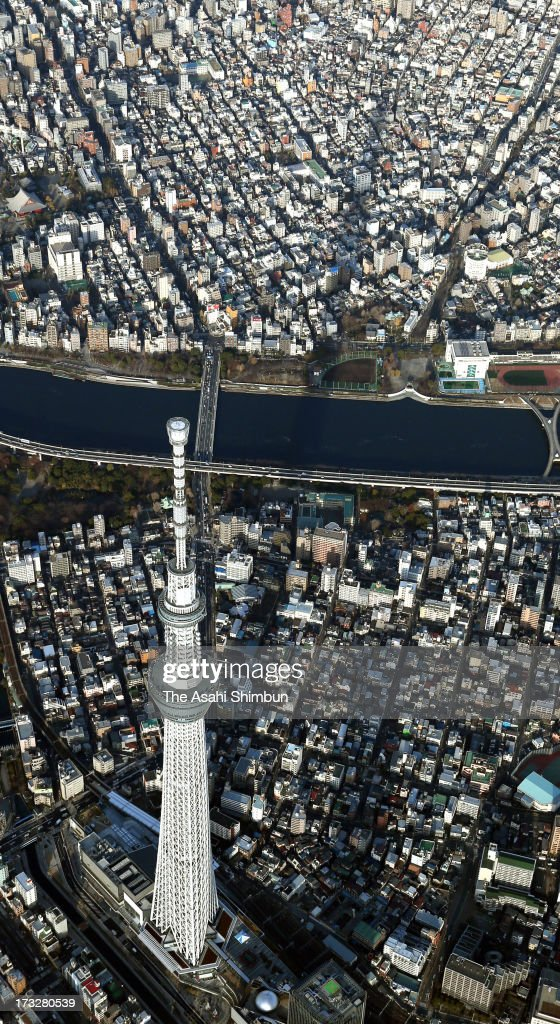 In this aerial image, The shadow of Tokyo Skytree lengthens over Tokyo on December 21, 2012 in Tokyo, Japan.