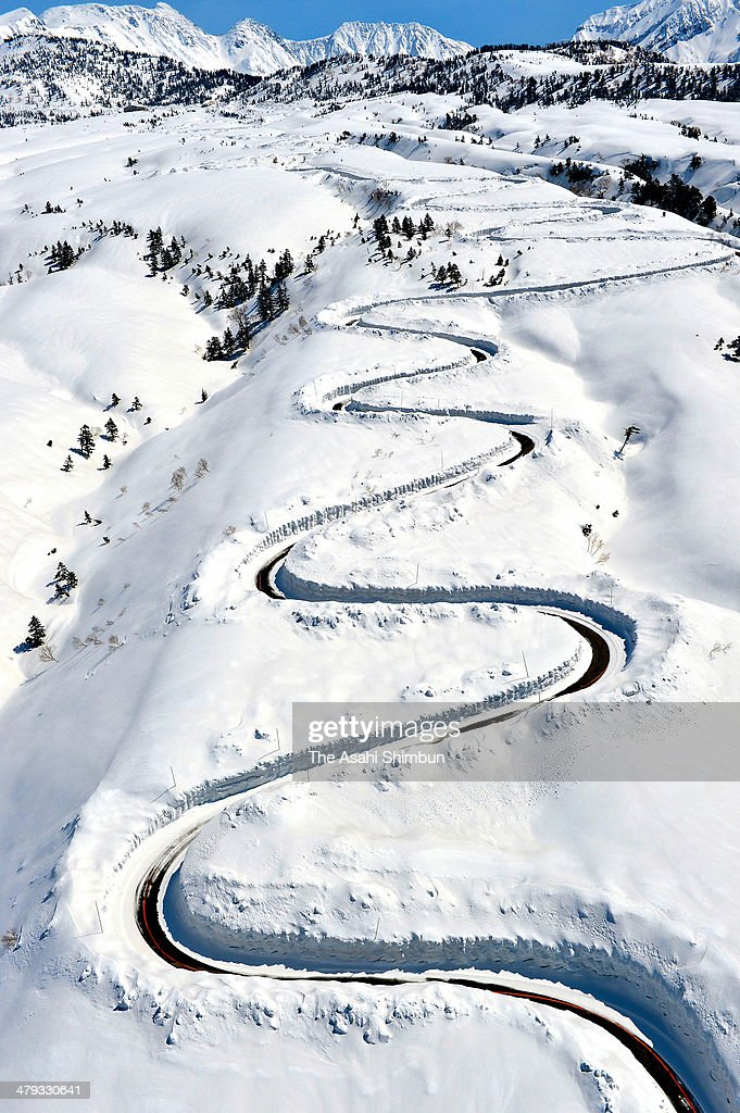 In this aerial image, the Tateyama Kurobe Alpine Route is seen as snow removal work continues on March 17, 2014 in Tateyama, Toyama, Japan. The route, connecting Toyama and Nagano prefectures throught the Hida Mountains, or the Northern Alps, will be open on April 22 for spring sightseeing season.