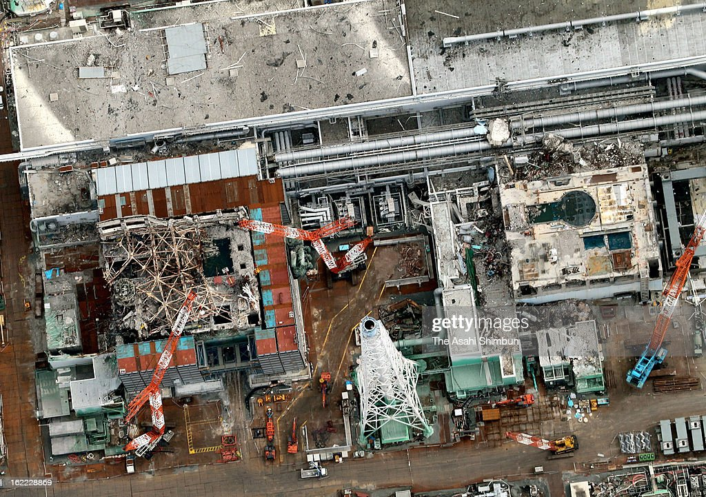 In this aerial image, the third reactor building (L) and fourth reactor building of Fukushima Daiichi Nuclear Power Plant are seen on February 20, 2013 in Okuma, Fukushima, Japan. The decommission work continues at the crippled plant in Fukushima, their operator Tokyo Electric Power Co and Japanese government plan to complete in around 2050.