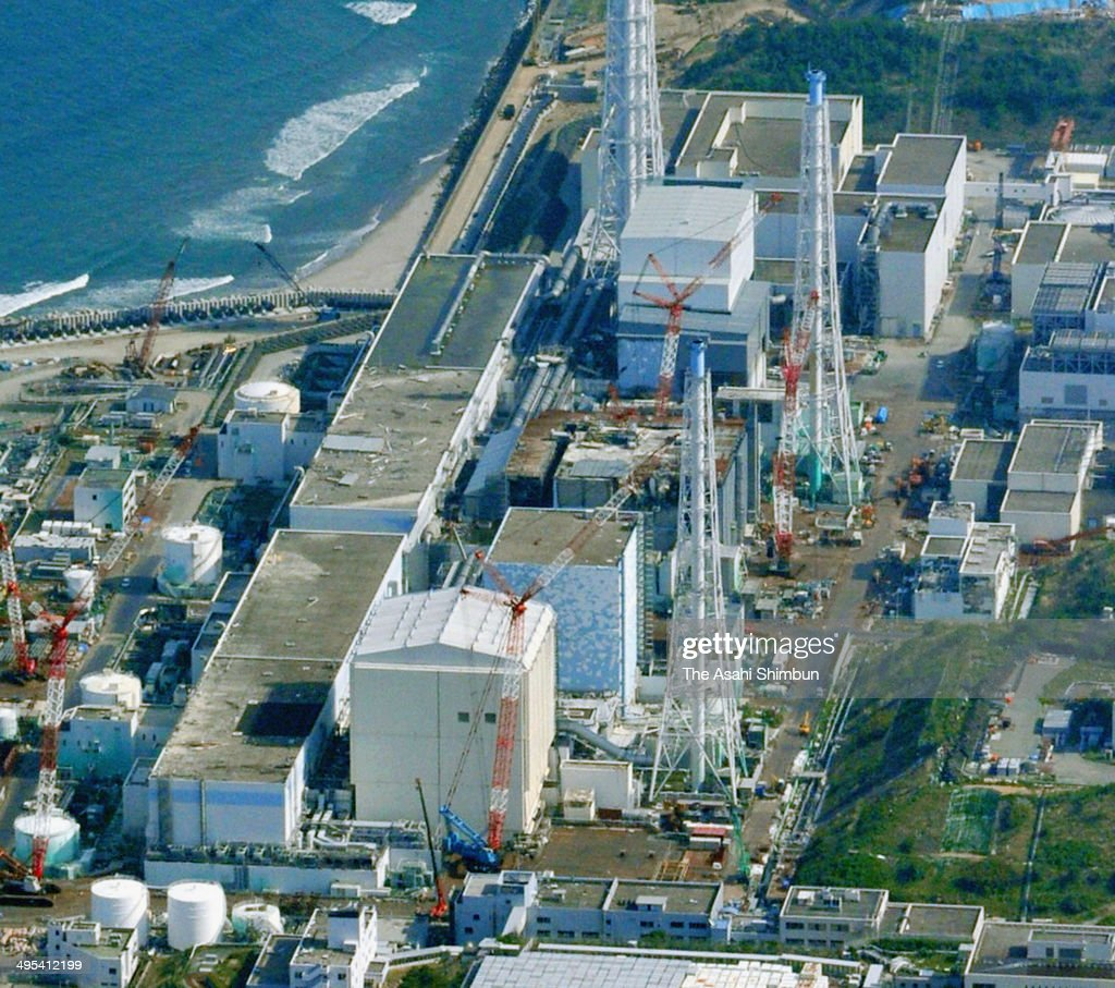In this aerial image, Tokyo Electric Power Co (TEPCO) Fukushima Daiichi Nuclear Power Plant is seen on June 2, 2014 in Okuma, Fukushima, Japan.The construction of the frozen underground soil wall to surround the reactor buildings begins. The construction of the wall aims to stop the flow of underground water, believed to be 400 tons a day.