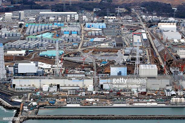 In this aerial image Tokyo Electric Power Co's Fukushima Daiichi Nuclear Power Plant is seen ahead of the fourth anniversary of the meltdown accident...