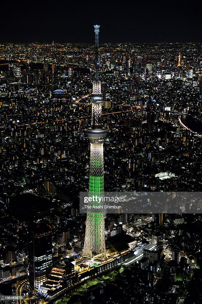 In this aerial image, Tokyo Skytree is illuminated in green as 'the tallest Christmas tree in the world' on November 15, 2012 in Tokyo, Japan. The special illumination will until December 25.