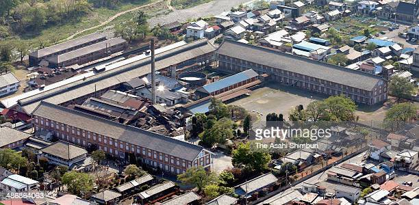 In this aerial image Tomioka Silk Mill is seen on April 26 2014 in Tomioka Gunma Japan Constructed by the Meiji government in 1872 the public silk...