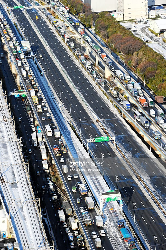 In this aerial image, traffic jam are seen in both direction as the Tokyo Metropolitan expressway is closed on January 15, 2013 in Tokyo, Japan. A strong low pressure system caused heavy snow and strong wind in the coast area including Tokyo, more than 500 injured.