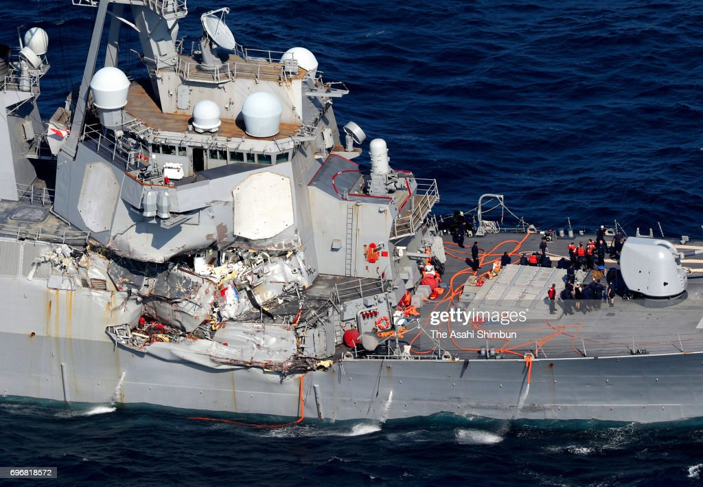In this aerial image, USS Fitzgerald, which starboard side is damaged, runs toward its Yokosuka Base after collision with the Philippine container ship off the coast of Shimoda on June 17, 2017 in Shimoda, Shizuoka, Japan. Seven U.S. Navy crew members are missing and three, including captain, were injured.
