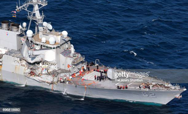 In this aerial image USS Fitzgerald which starboard side is damaged runs toward its Yokosuka Base after collision with the Philippine container ship...