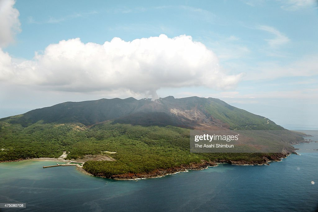 In this aerial image, volcanic ash spews from Mount Shindake at Kuchinoerabu Island on August 12, 2014 in Yakushima, Kagoshima, Japan.