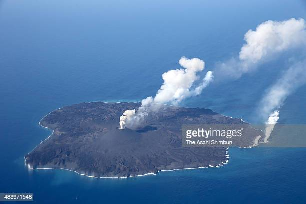In this aerial image volcanic eruption continues at Nishinoshima island in Ogasawara Chain islands on March 4 2015 in Ogasawara Tokyo Japan The islet...