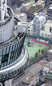 In this aerial image window cleaners work at Tokyo Skytree tower on May 18 2015 in Tokyo Japan Two window cleaners were washing the windows of the...