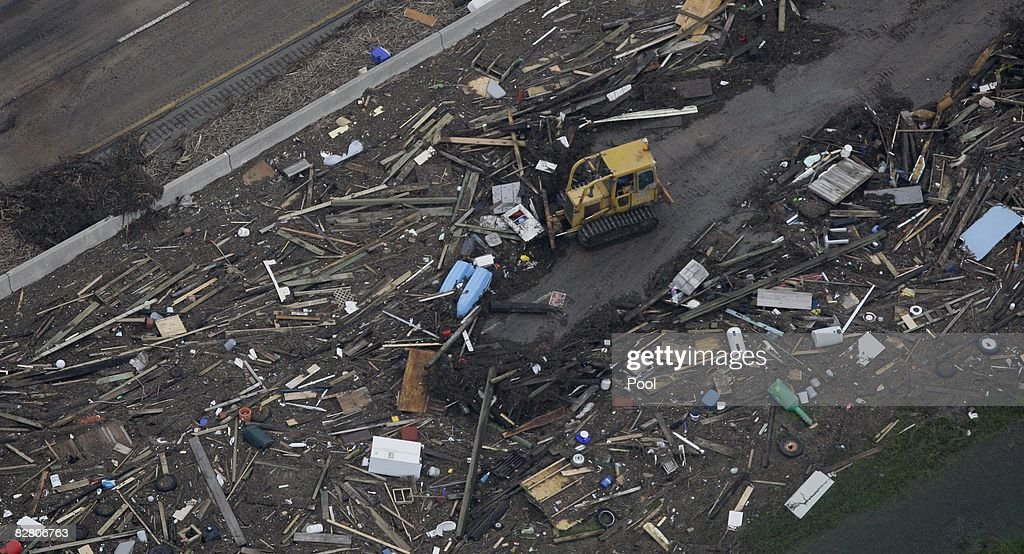 In this aerial photo, a bulldozer clears debris along Interstate 45 after Hurricane Ike hit September 13, 2008 in Galveston, Texas. Ike caused extensive damage along the Texas Gold Coast, leaving millions without power.