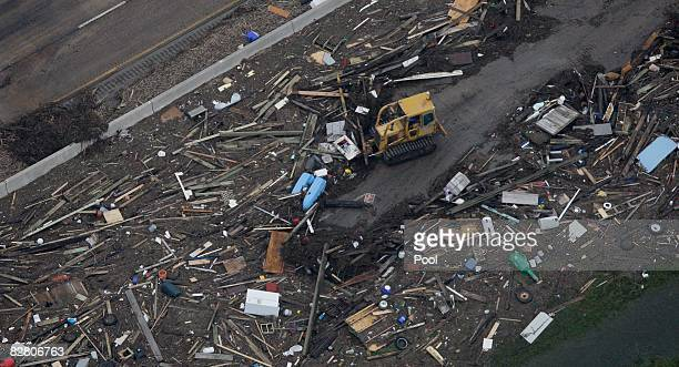 In this aerial photo a bulldozer clears debris along Interstate 45 after Hurricane Ike hit September 13 2008 in Galveston Texas Ike caused extensive...