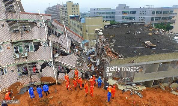 In this aerial photograph Chinese rescuers work at the site of a landslide that hit an industrial park in Shenzhen in south China's Guangdong...