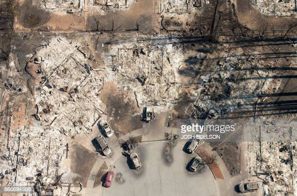 TOPSHOT In this aerial view a burned neighborhood is seen in Santa Rosa California on October 12 2017 Hundreds of people are still missing in massive...