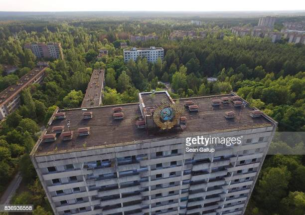 In this aerial view a Sovietera hammer and sickle stand on an apartment building in the abandoned city of Pripyat near the Chernobyl nuclear power...