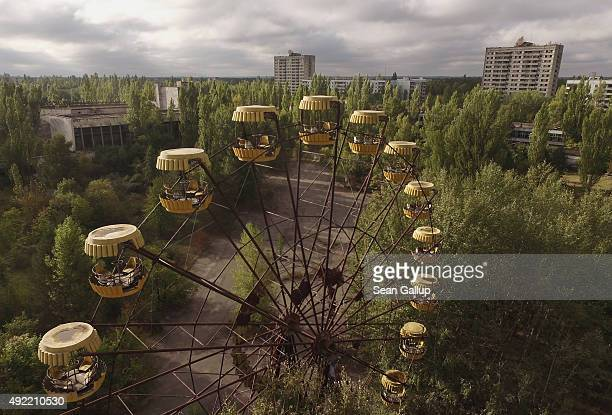 In this aerial view an abandoned ferris wheel stands on a public space overgrown with trees in the former city center on September 30 2015 in Pripyat...