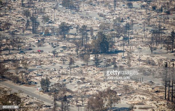 TOPSHOT In this aerial view burned properties are seen in Santa Rosa California on October 12 2017 Hundreds of people are still missing in massive...