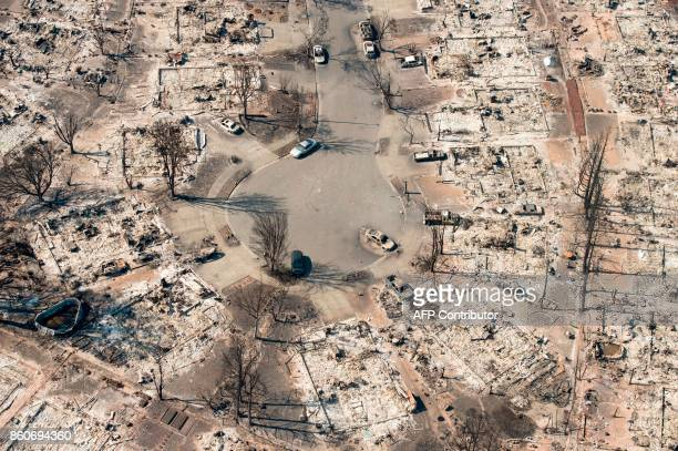 In this aerial view burned properties are seen in Santa Rosa California on October 12 2017 Hundreds of people are still missing in massive wildfires...