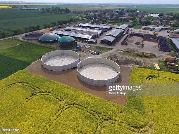 In this aerial view concrete containers that will serve to expand the biogas power facility of the adjacent dairy farm stand under construction on...