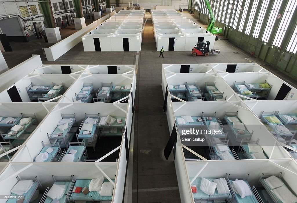 In this aerial view cubicles furnished with bunk beds stand ready to accommodate refugees and asylum applicants in Hangar 6 of former Tempelhof Airport on February 11, 2016 in Berlin, Germany. Tempelhof, once an airport in the city center and first built in the 1930s, now houses approximately 2,600 refugees in three former hangars. Berlin city authorities recently approved plans to expand its capacity to house the newcomers with an additional 90 shelters with space for 30,000 people. An estimated 50,000-80,000 migrants and refugees already live in Berlin. Germany received 1.1 million refugees and migrants in 2015 and is expecting to continue to receive large numbers in 2016.