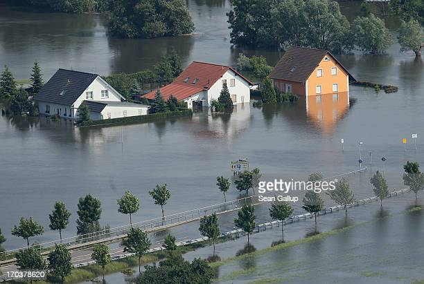 In this aerial view houses and a road stand partially submerged in floodwaters from the Elbe river on June 12 2013 in Fischbeck Germany The swollen...