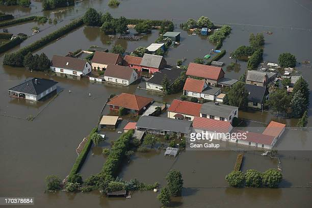 In this aerial view houses stand partially submerged in floodwaters from the Elbe river on June 12 2013 in Fischbeck Germany The swollen Elbe is...