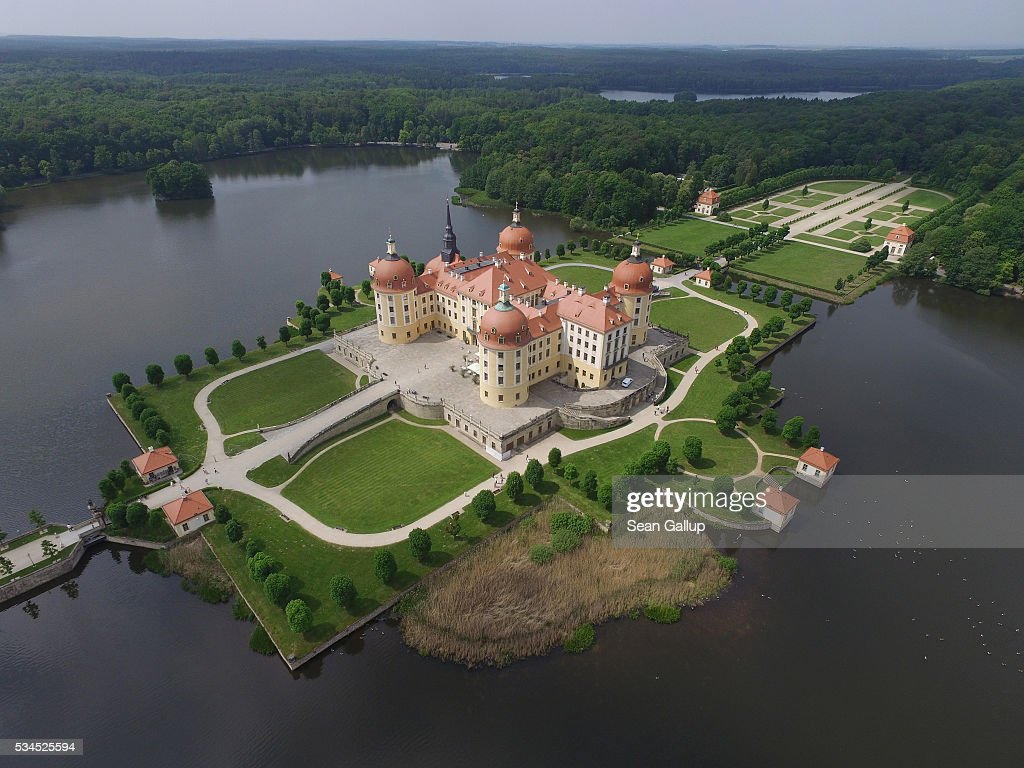 In this aerial view Moritzburg Castle (Schloss Moritzburg) stands on May 26, 2016 in Moritzburg, Germany. Moritzburg Castle is a Baroque palace that was originally built as a hunting lodge in the 16th century for Moritz, Duke of Saxony. Today it is among Saxony's main tourist attractions.