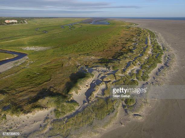 In this aerial view protected dunes and saltwater marshes stretch along the beach on July 18 2016 at SanktPeterOrding Germany SanktPeterOrding is...