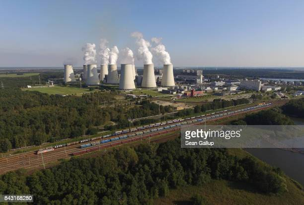 In this aerial view steam rises from cooling towers at the Jaenschwalde coalfired power plant on September 5 2017 near Peitz Germany Germany is...