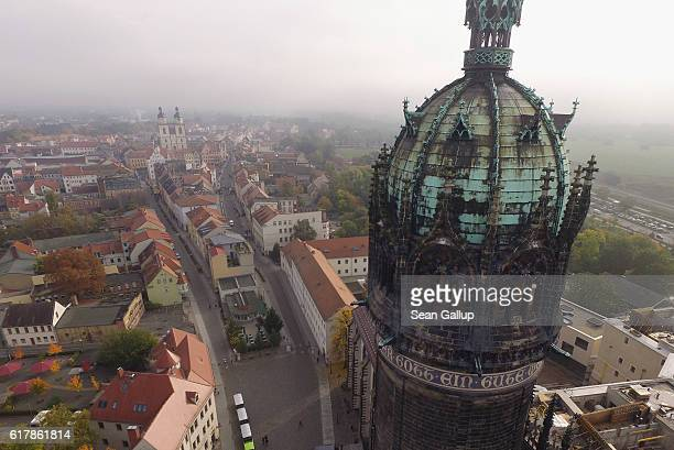 In this aerial view the Schlosskirche church on whose doors theologian Martin Luther nailed his 95 theses in 1517 stands as the Stadtkirche Sankt...