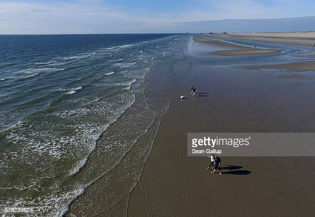 In this aerial view visitors walk along the beach on July 18 2016 at SanktPeterOrding Germany SanktPeterOrding is among the top destinations for...