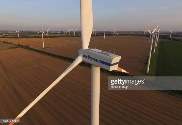 In this aerial view wind turbines spin at a windpark on August 23 2017 near Gross Santersleben Germany Germany is making strong progress in meeting...