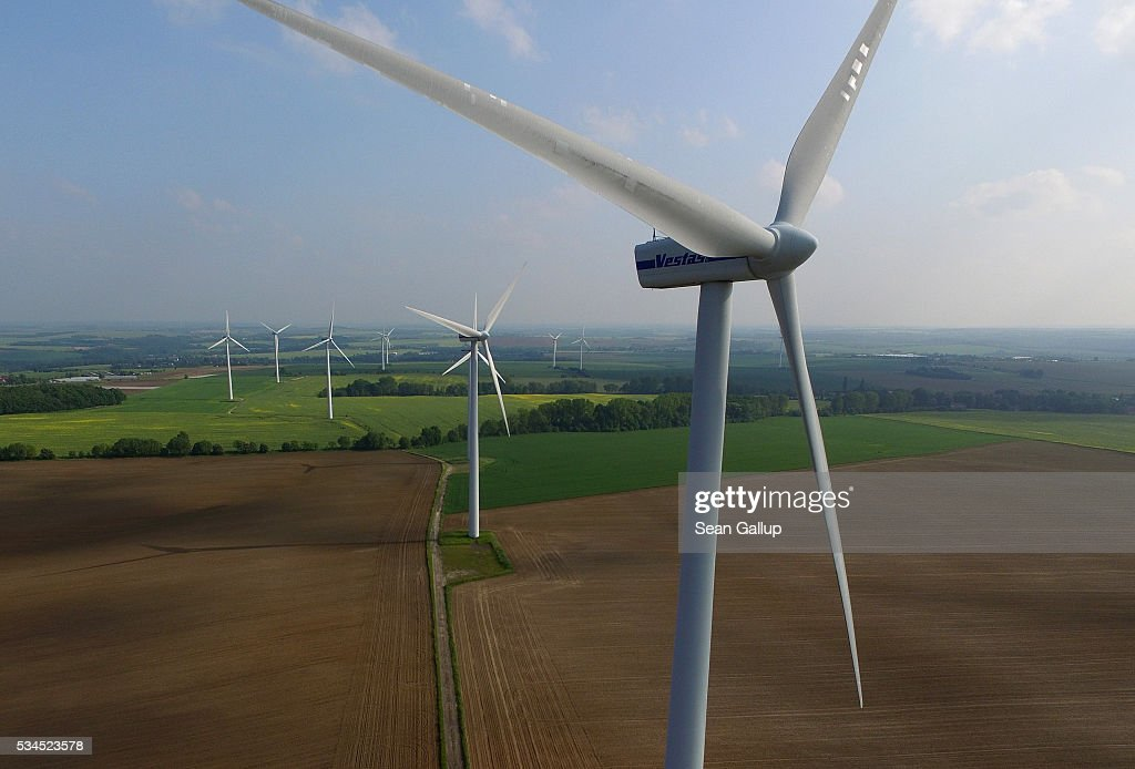 In this aerial view wind turbines spin on May, 2016 near Gohla, Germany. Germany is investing heavily in renewable energy sources, including wind farms and solar fields, in an effort to cut climate warming emissions and replace nuclear power.