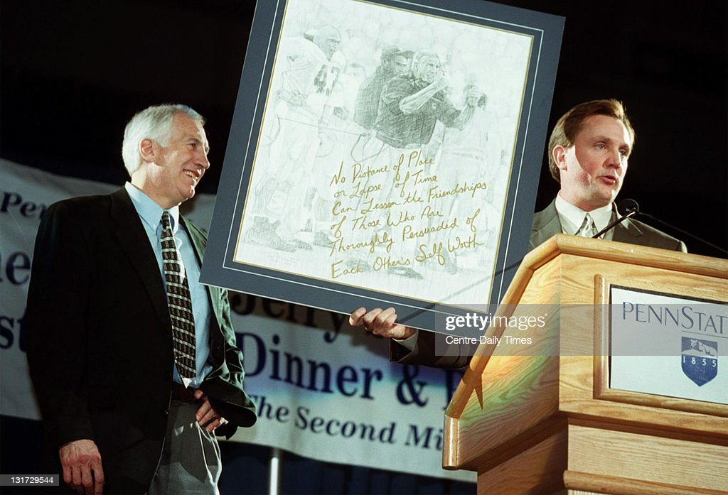 In this April 14, 2000 file photograph, former Penn State defensive coordinator Jerry Sandusky, left, gets ready to accept a drawing from New Penn State defensive coach Tom Bradly as he finishes roasting him. On November 5, 2011, Sandusky was arrested on charges that he preyed on boys he met through The Second Mile, a charity he founded for at-risk youths. He faces charges including seven counts of first-degree involuntary deviate sexual intercourse, all of which are punishable by up to 20 years in prison and a $25,000 fine.