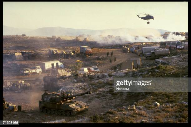 In this archive image provided by the Israeli Government Press Office an Israeli Air Force helicopter ferries supplies to an army encampment during...