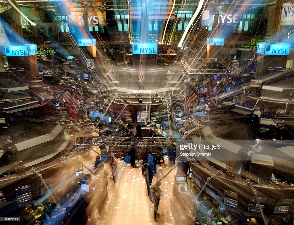 In this camera effect image, traders and others work on the floor of the New York Stock Exchange April 25, 2003 in New York City. The Dow Jones Industrial average closed at 8306, down 133 points.