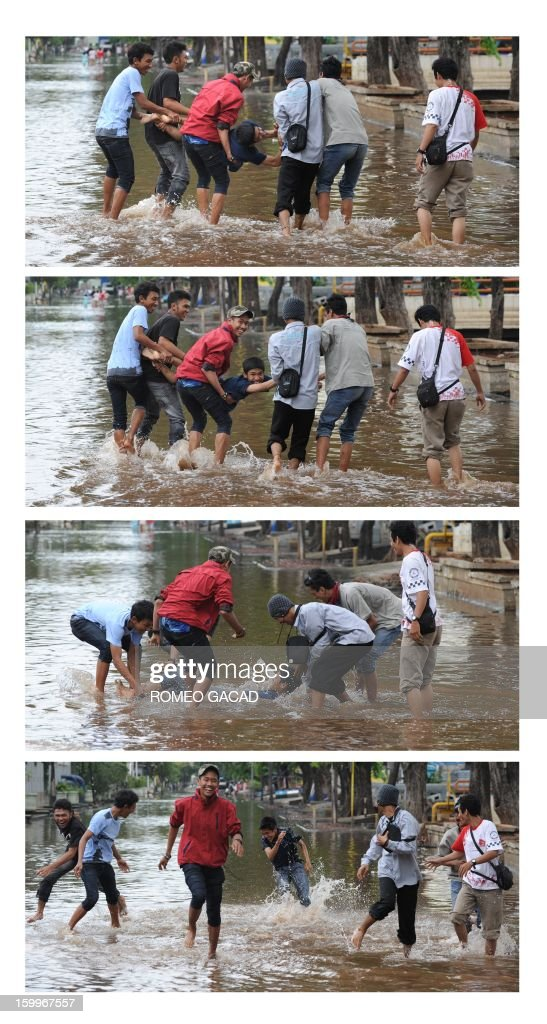 In this combo pictures, Indonesian volunteers dunk their colleague in the floodwaters after distributing relief goods to flood victims in Jakarta on January 24, 2013. Indonesia's National Disaster Mitigation Agency (BNPB) said more than 30,000 people were displaced while 20 people died during the widespread flooding that hit Jakarta as the weather bureau forecast more rains in the coming days. AFP PHOTO / ROMEO GACAD