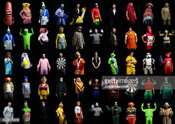In this composite 50 images of darts fans wear fancy dress while attending Day Eleven of the 2016 William Hill PDC World Darts Championships at...
