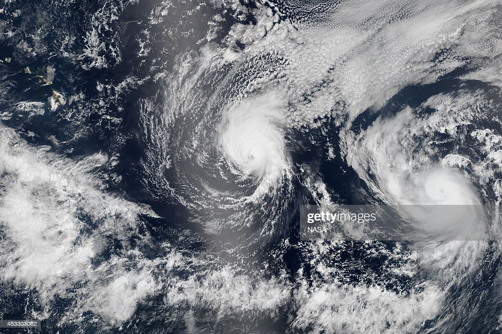 In this composite image provided by NASA, Hurricane Iselle (L) is followed by Hurricane Julio as they approach Hawaii from the east in early August, 2014. Hurricane Iselle is exppected to make landfall on August 7th, making it Hawaii's first hurricane in 22 years. This image is a composite of three satellite passes over the tropical Pacific Ocean of August 5th.