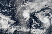 In this composite image provided by NASA Hurricane Iselle is followed by Hurricane Julio as they approach Hawaii from the east in early August 2014...