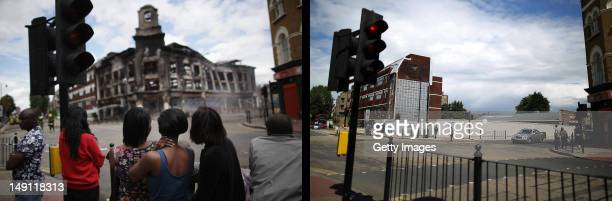 In this composite image Residents watch as a building burns after riots on Tottenham High Road on August 7 2011 in London England The scene on...