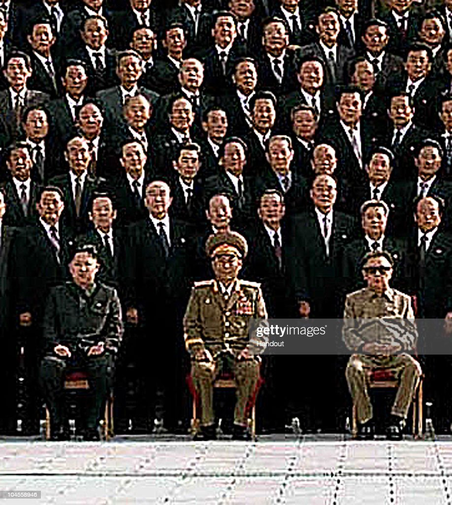 In this detail from a photo released by Korean Central News Agency via Korean News Service on September 30, 2010 North Korean leader Kim Jong-Il (R, front row) and the man believed to be his son Kim Jong-un, (L, front row) pose for photographs with delegates of the Workers' Party of Korea at the Kumsusan Memorial Palace in Pyongyang, North Korea. North Korean leader Kim was re-appointed as the party's secretary general and has made a military general of Kim Jong-Un, believed to be his third son.