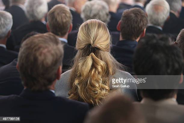 In this file photo a woman surrounded by men attends the annual congress of the German Federation of Industry on November 3 2015 in Berlin Germany...