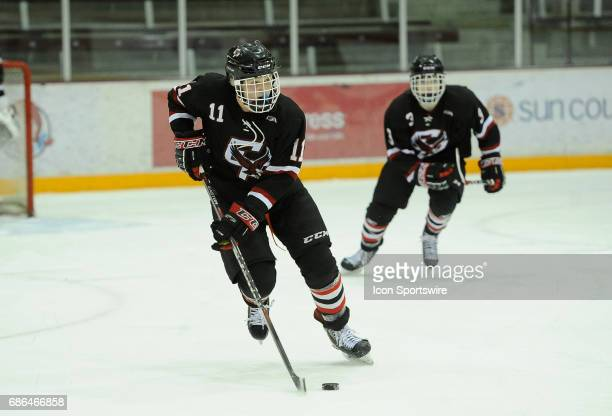 In this file photo Eden Prairie Eagles forward Casey Mittelstadt carries the puck against the Burnsville Blaze during a prep hockey game at Ridder...
