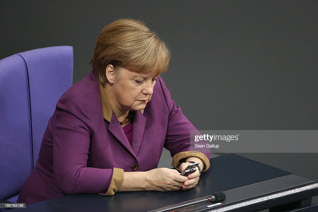 In this file photo German Chancellor Angela Merkel checks her mobile phone during a session of the Bundestag on November 30, 2012 in Berlin, Germany. German media reported on October 24, 2013 that German authorities had evidence that the National Security Agency has been eavesdropping on Merkel's mobile phone. Merkel telephoned the same day with U.S. President Barack Obama to complain and the incident has caused an international outcry among politicians across Europe.