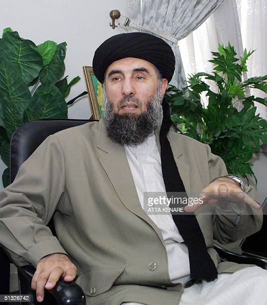 In this file photo taken 17 October 2001 Gulbuddin Hekmatyar a former Afghan warlord in exile in Iran gives an interview to AFP in Tehran Afghan...