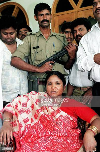 In this file photo taken 24 April 1996 Phoolan Devi backed by a bodyguard and supporters stops during her political campaign to be photographed in...