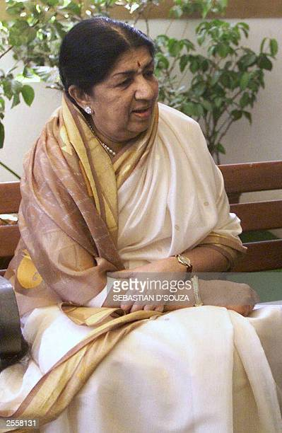 In this file photo taken 28 March 2003 Indian singer Lata Mangeshkar pauses for thought during a meeting with Indian cricketer Sachin Tendulkar in...